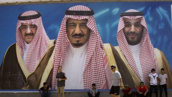 Изображение короля Саудовской Аравии, наследного принца и заместителя наследного принца страны в городе Таиф. Архивное фото