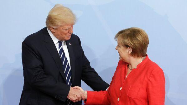 Дональд Трамп и Ангела Меркель. Архивное фото