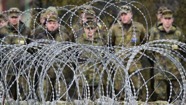 Солдаты на построении в многонациональном корпусе НАТО в Польше. Июль 2017