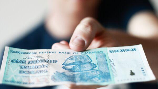 Купюра номиналом 100 триллионов долларов Зимбабве