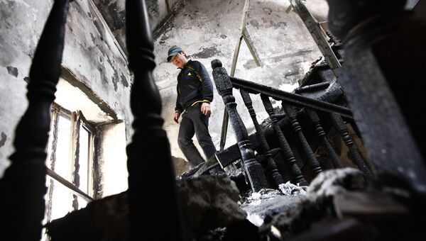 Последствия погрома в городском доме президента Киргизии Курманбека Бакиева