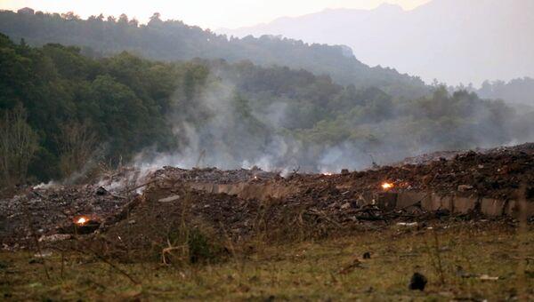 На месте взрыва боеприпасов склада Минобороны Абхазии в селе Приморское
