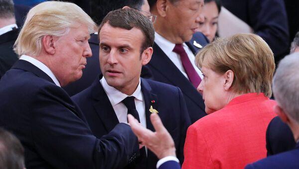 Президент США Дональд Трамп, президент Франции Эммануэль Макрон и федеральный канцлер Германии Ангела Меркель. Архивное фото
