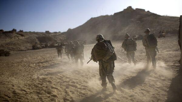 Военнослужащие США возвращаются в форпост после патрулирования в провинции Кандагар, Афганистан