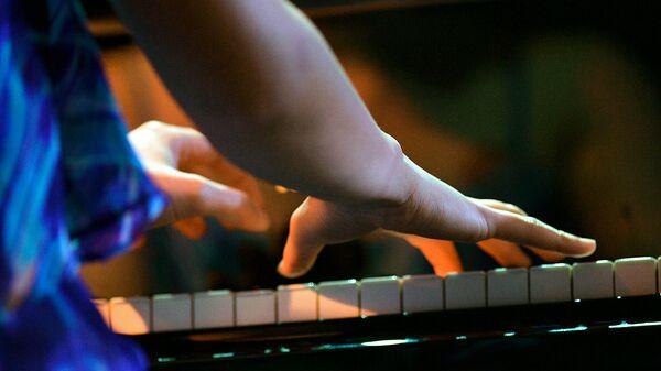 Игра на фортепиано. Архивное фото