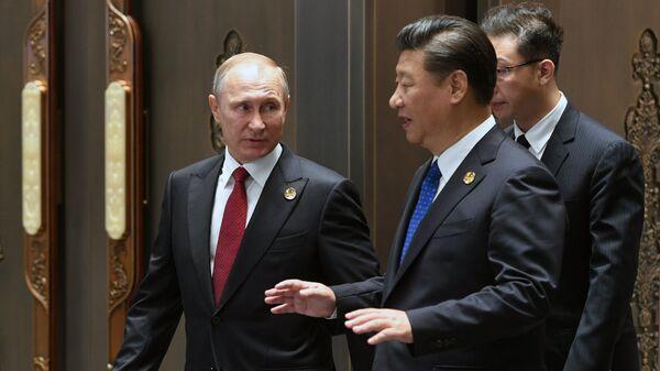 Президент РФ Владимир Путин и председатель КНР Си Цзиньпин.