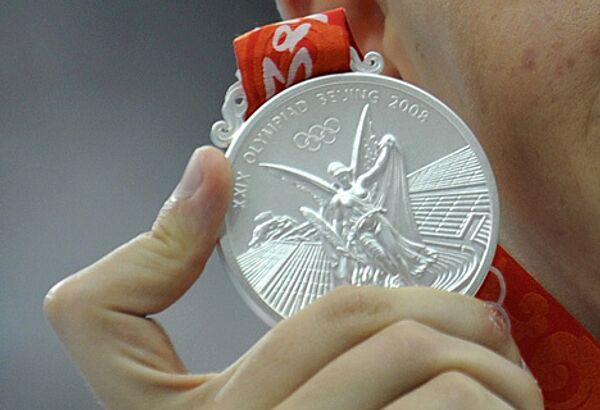 Серебряная Олимпийская медаль