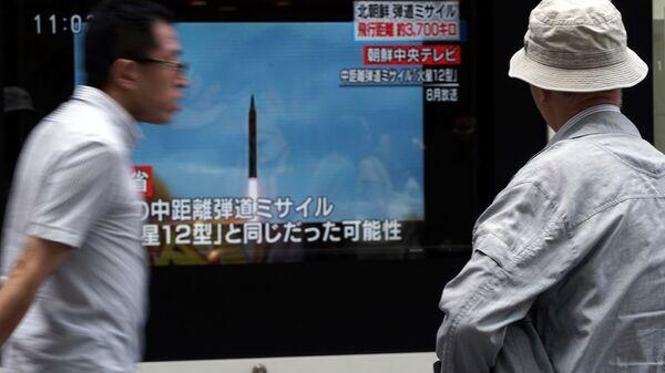 Трансляция новостей в Токио о новом ракетном пуске КНДР