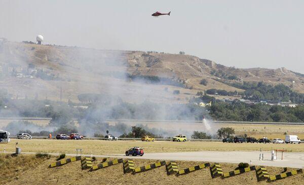 Место аварии самолета в аэропорту Мадрида