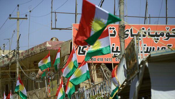 Агитационные плакаты, призывающие прийти на участки и проголосовать на референдуме о независимости Иракского Курдистана от Багдада, в Эрбиле. 23 сентября 2017