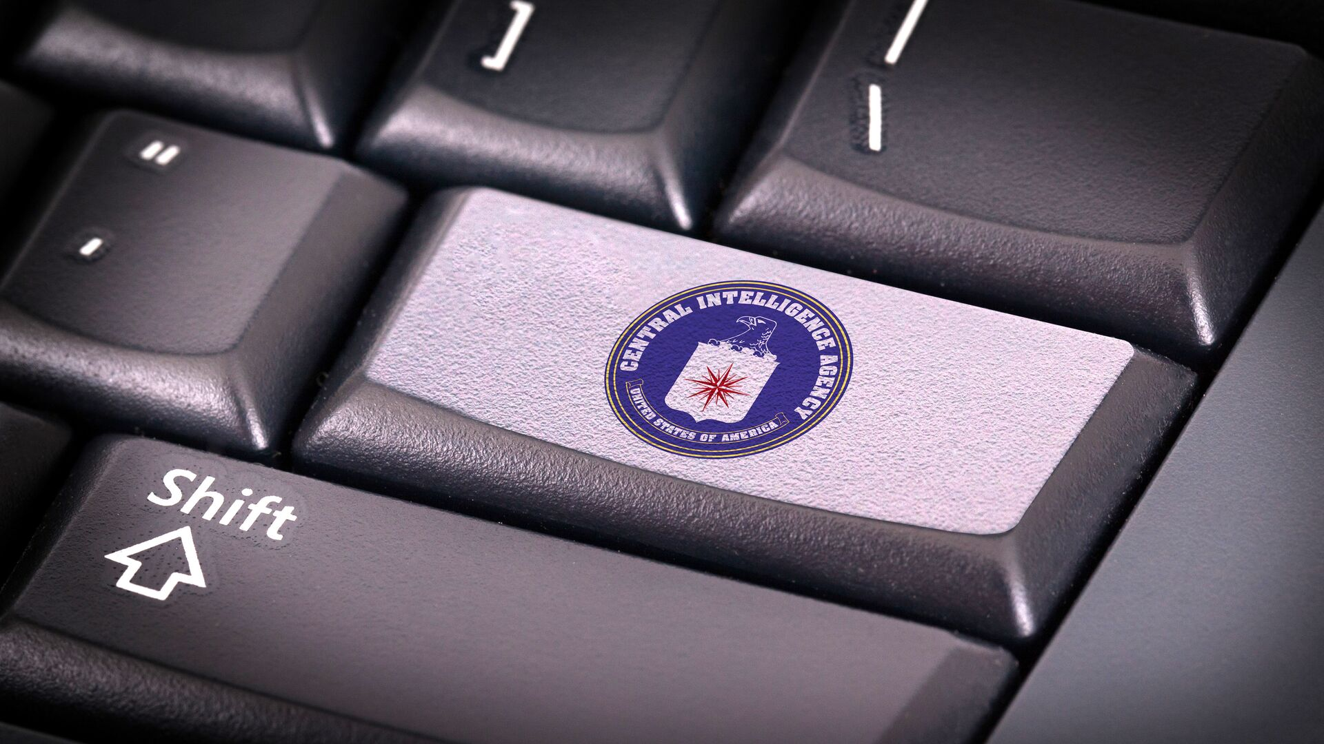 Логотип ЦРУ на клавиатуре - РИА Новости, 1920, 07.10.2021