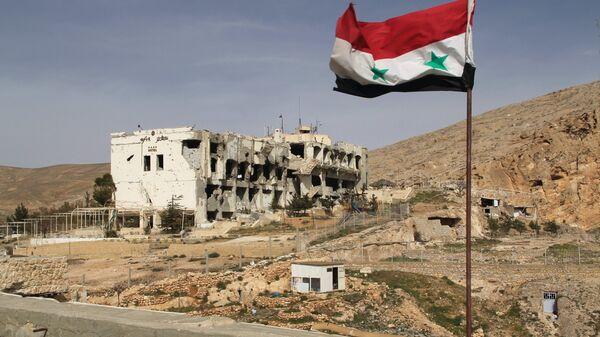Разрушенное здание в Сирии