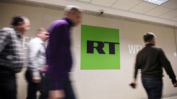 Сотрудники в офисе телеканала RT в Москве. Архивное фото
