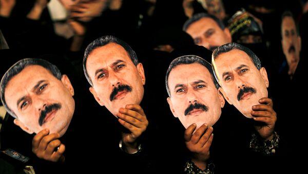 Портреты президента Йемена Али Абдаллы Салеха во время митинга в его поддержку в Сане. Архивное фото