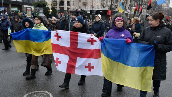 Участники акции протеста сторонников экс-президента Грузии Михаила Саакашвили с требованием принятия закона об импичменте в Киеве. 10 декабря 2017