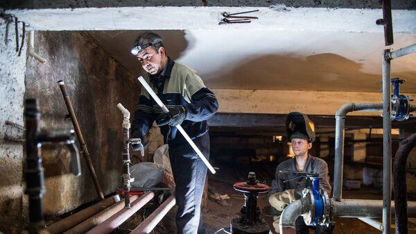 Ремонт отопительной системы в подвале жилого дома