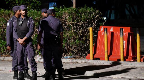 Сотрудники правоохранительных органов в Мале, Мальдивы.