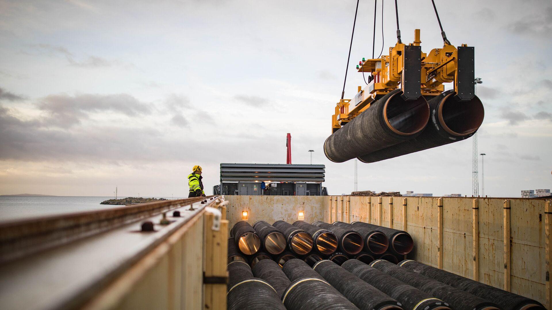 Трубы для строительства газопровода Северный поток — 2 в порту Мукран, Германия - РИА Новости, 1920, 22.07.2021