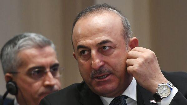 Министр иностранных дел Турции Мевлют Чавушоглу на встрече глав МИД стран-гарантов перемирия в Сирии, которая проходит в Астане. 16 марта 2018