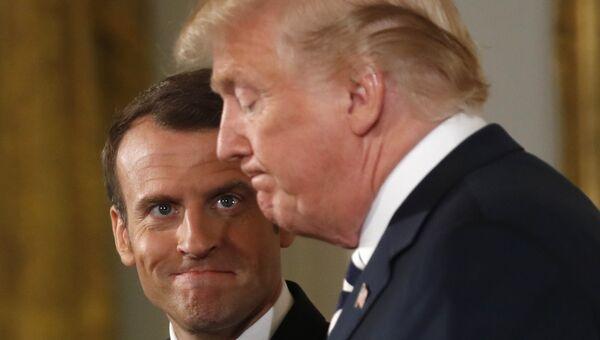 Президент Франции Эммануэль Макрон и президент США Дональд Трамп во время встречи в Белом доме, США. 24 апреля 2018