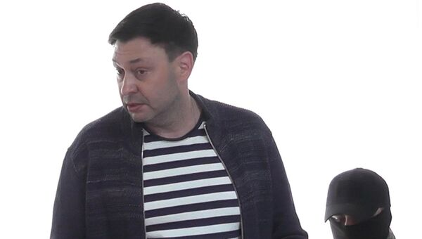 Руководитель портала РИА Новости Украина Кирилл Вышинский в Херсонском зале суда по подозрению в госизмене и поддержке самопровозглашенных республик Донбасса. 17 мая 2018