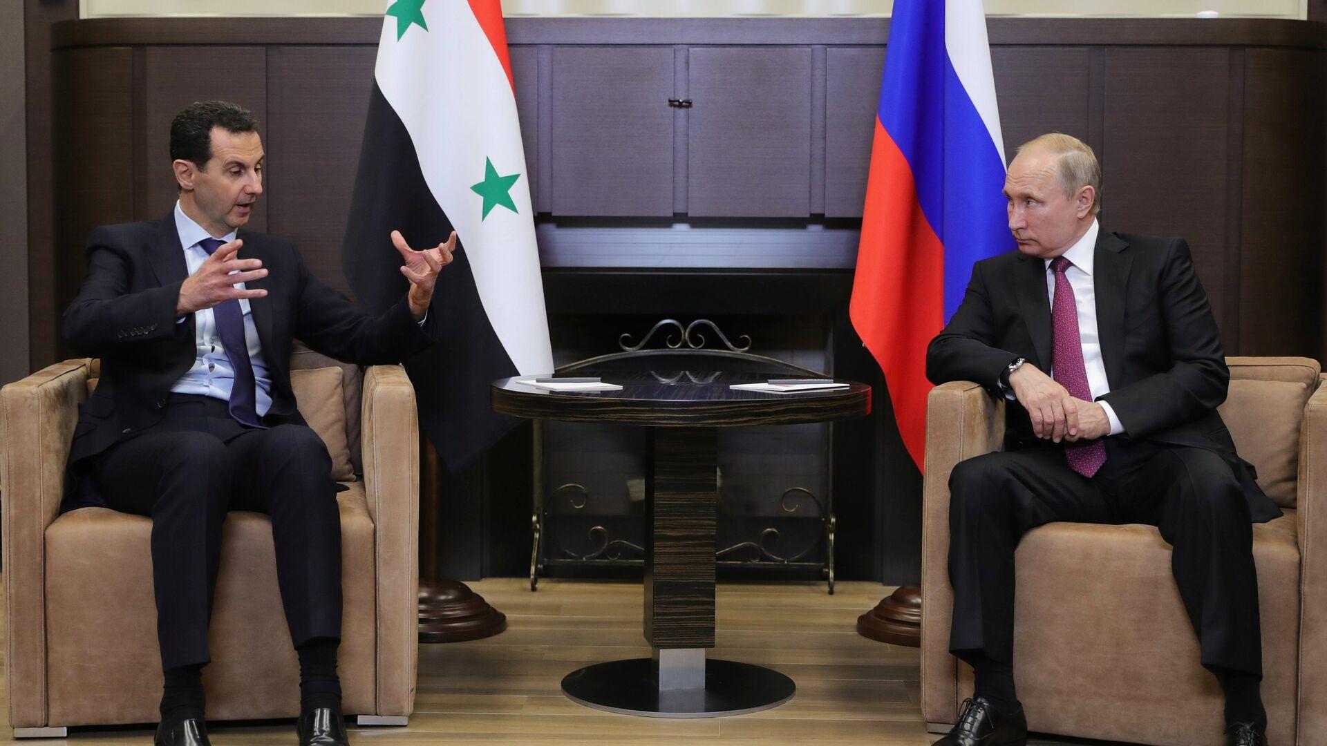 Президент РФ Владимир Путин и президент Сирийской арабской республики Башар Асад во время встречи. 17 мая 2018 - РИА Новости, 1920, 14.09.2021