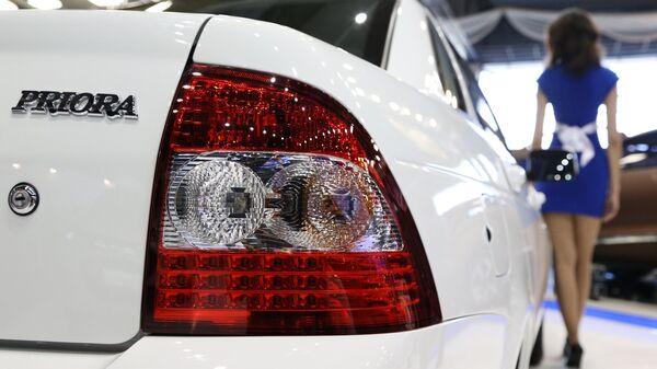 Обновленная модель автомобиля Lada Priora на автосалоне MOTOREXPO 2013 в Тольятти