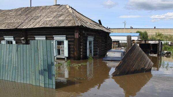 Частный дом, затопленный в результате паводка