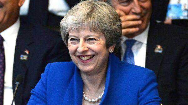 Премьер-министр Великобритании Тереза Мэй на саммите стран-участниц НАТО в Брюсселе. 11 июля 2018