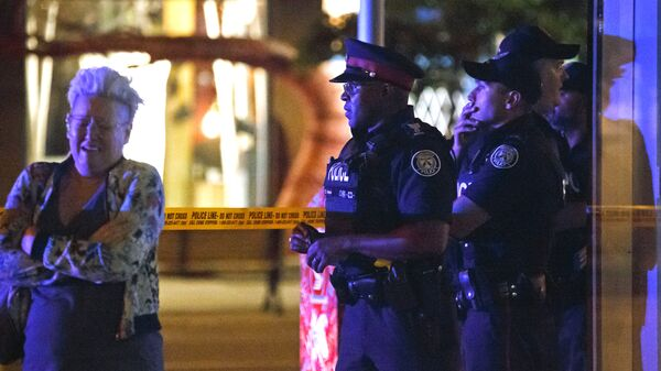 Полиция на месте стрельбы в Торонто, Канада. Архивное фото
