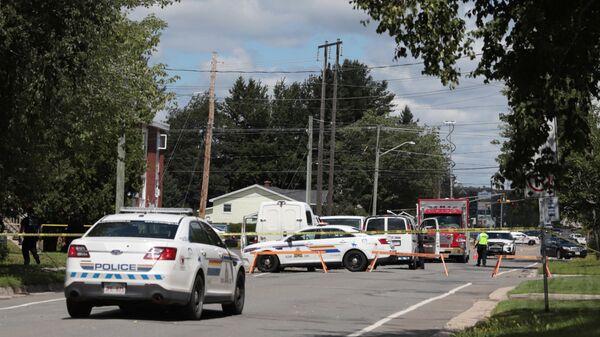 Полиция на месте стрельбы в городе городе Фредериктон в канадской провинции Нью-Брансуик. 10 августа 2018