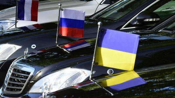 Флаги на автомобилях министров иностранных стран-участниц Нормандского формата
