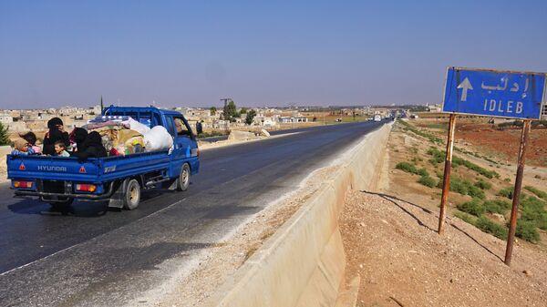 Люди в автомобиле в провинции Идлиб. Архивное фото