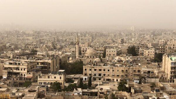 Разрушенные и поврежденные здания в Алеппо в результате военных действий