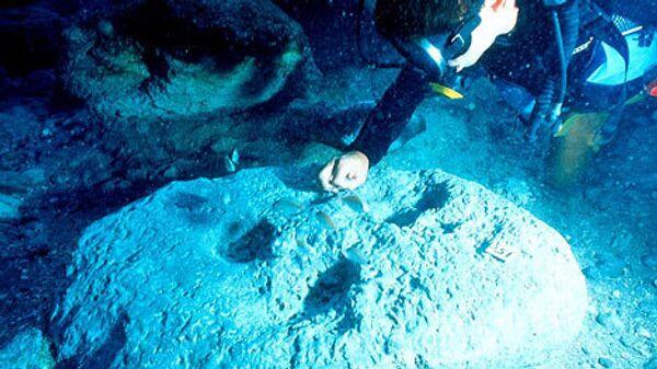 Подводные археологи за работой