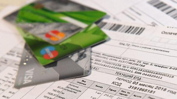 Банковские карты и единый платежный документ оплаты услуг ЖКХ города Москвы