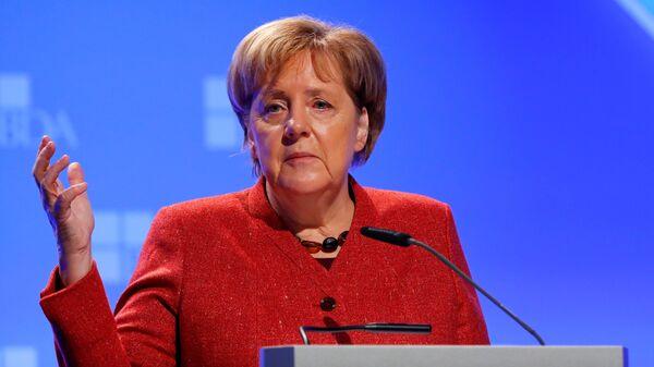 Канцлер Германии Ангела Меркель выступает перед союранием Конфедерации ассоциаций работодателей Германии во время Дня работодателей в Берлине, Германия. 22 ноября 2018
