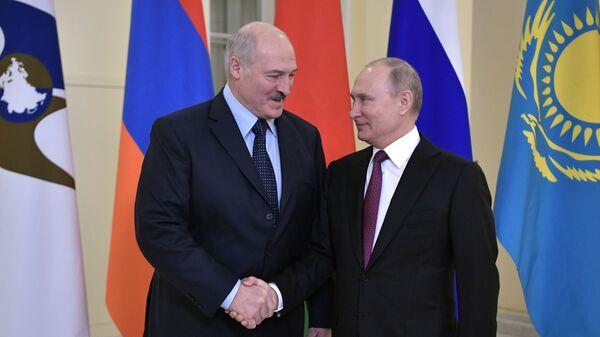 Владимир Путин и президент Белоруссии Александр Лукашенко перед заседанием Высшего Евразийского экономического совета. 6 декабря 2018
