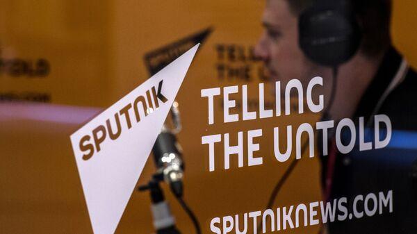 Стенд Информационного агентства и радио Sputnik