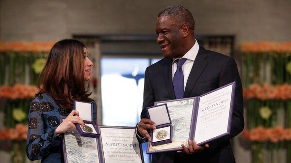 Лауреаты Нобелевской премии мира Надя Мурад и Денис Муквеге на церемонии вручения наград в Осло. 10 декабря 2018