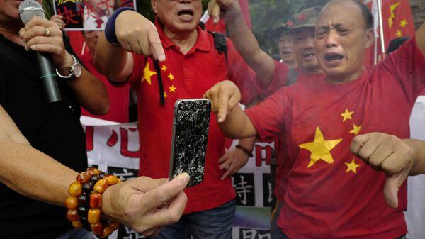 Митинг против торговой политики президента США Дональда Трампа в Гонконге. Архивное фото