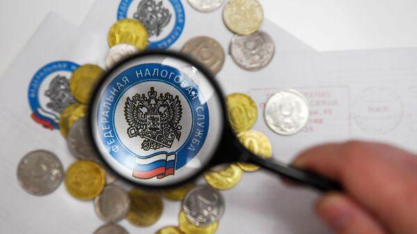 Монеты России и конверты с логотипом ФНС РФ