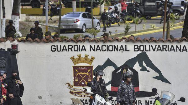 Ситуация у здания штаб-квартиры Боливарианской национальной гвардии в Каракасе, Венесуэла