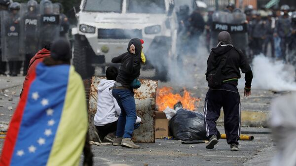 Акция протеста против президента Венесуэлы Николаса Мадуро в Каракасе