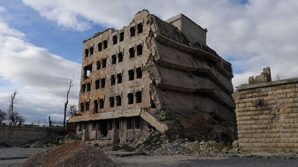 Разрушенные здания в районе Алеппо