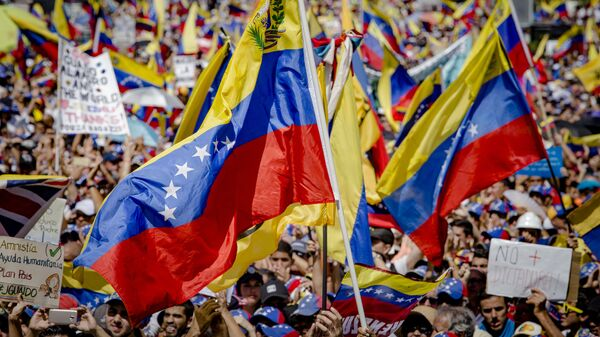 Акция в поддержку лидера оппозиции Хуана Гуаидо в Каракасе