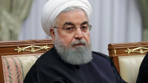 Президент Исламской Республики Иран Хасан Рухани во время беседы с президентом РФ Владимиром Путиным в Сочи