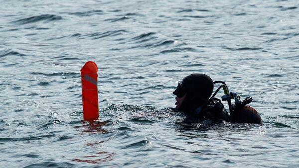 Водолаз во время конкурса водолазных специалистов