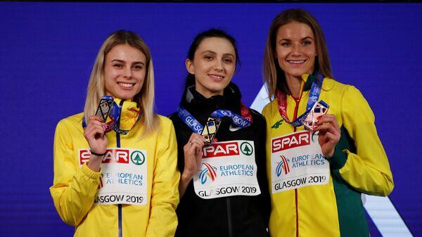 Юлия Левченко, Мария Ласицкене и Айрине Пальшите