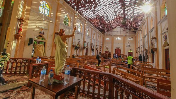 На месте взрыва в церкви Святого Себастьяна в Негомбо, Шри-Ланка. 21 апреля 2019